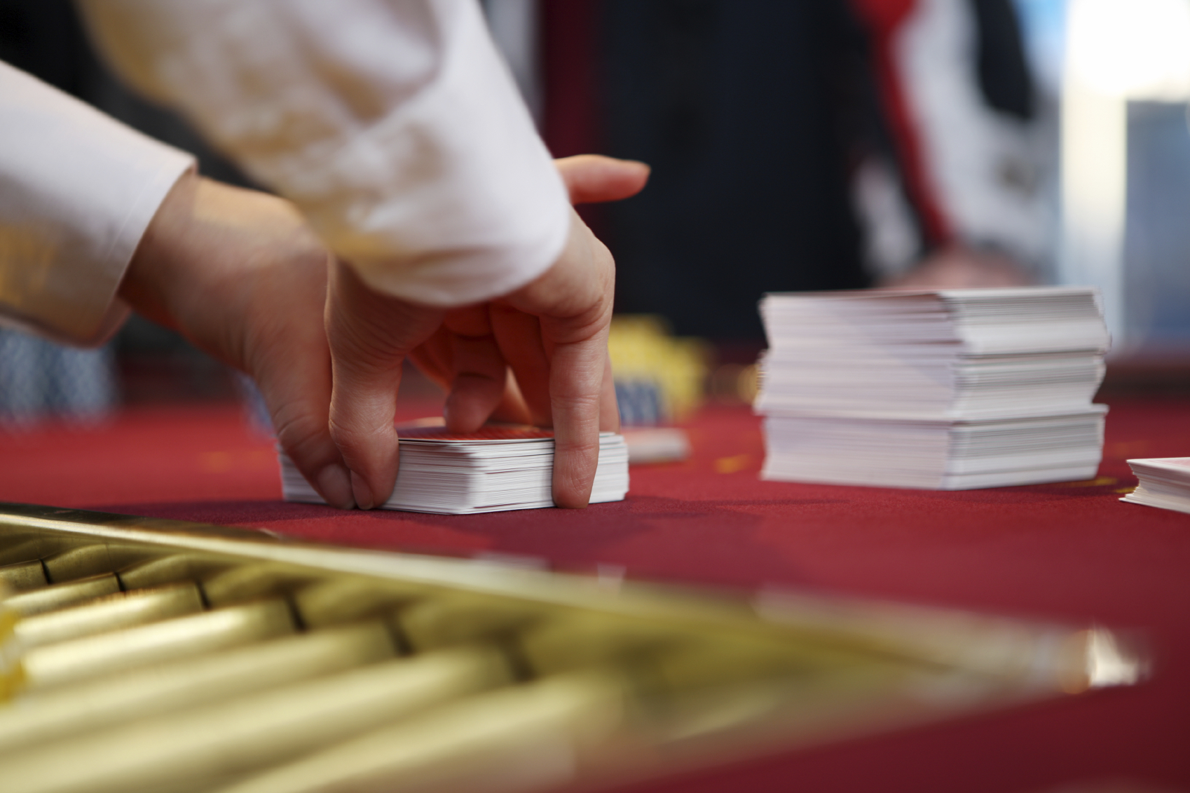 Man dealing cards, blurred, space for copy, canon 1Ds mark III